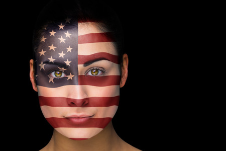 Composite image of usa football fan in face paint against black photo