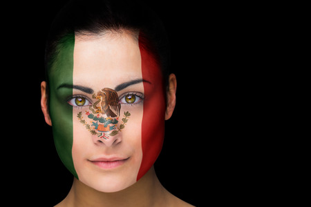 Composite image of mexico football fan in face paint against black photo
