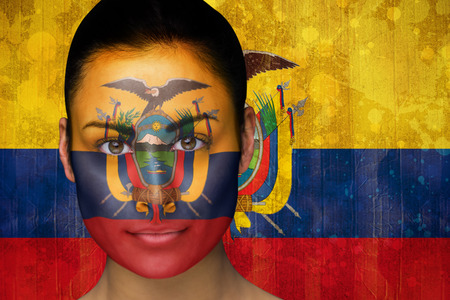 Composite image of beautiful football fan in face paint against ecuador flag in grunge effect photo
