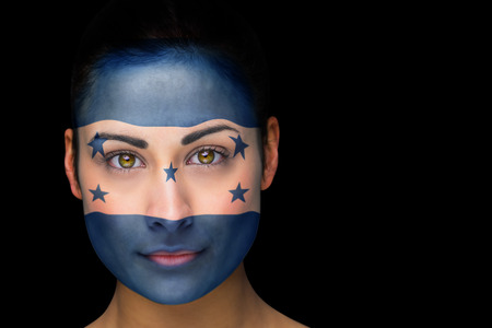 Composite image of honduras football fan in face paint against black photo