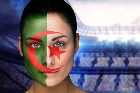 Composite image of beautiful iran fan in face paint against large football stadium with lights photo