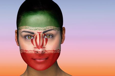 Composite image of beautiful brunette in iran facepaint against beautiful orange and blue sky photo