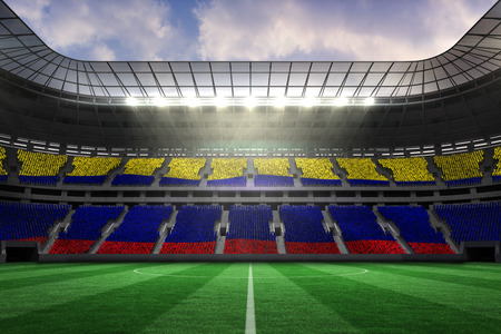 Digitally generated colombia national flag against large football stadium