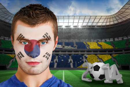 Composite image of serious young korea fan with face paint against large football stadium photo