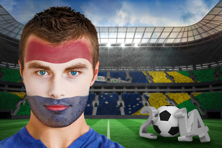 Composite image of serious young russia fan with face paint against large football stadium photo