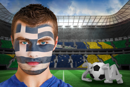 Composite image of serious young greece fan with face paint against large football stadium photo