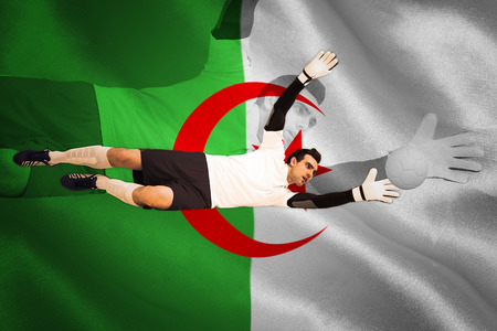 Goalkeeper in white making a save against algerian flag photo