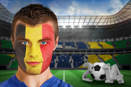 Composite image of serious young belgium fan with face paint against large football stadium with brasilian fans photo