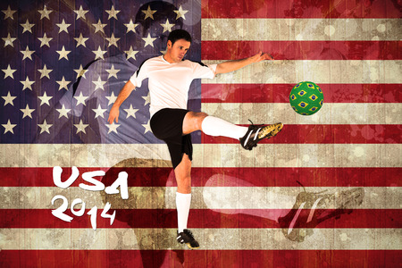 Football player in white kicking against usa flag in grunge effect photo