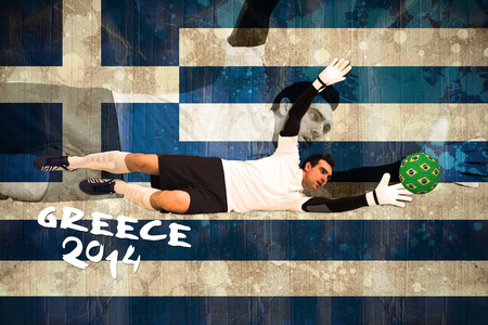 Goalkeeper in white making a save against greece flag in grunge effect photo