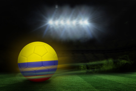 Football in colombia colours against football pitch under spotlights photo