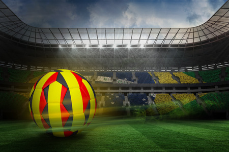 Football in belgian colours against large football stadium with brasilian fans photo