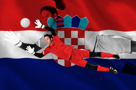 Fit goal keeper jumping up against digitally generated croatia national flag photo