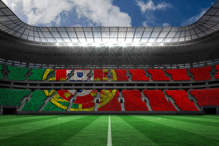 portugese: Digitally generated portugese national flag against large football stadium