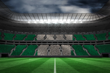 Digitally generated nigerian national flag against large football stadium