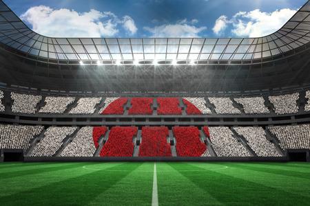 Digitally generated japan national flag against large football stadium  photo