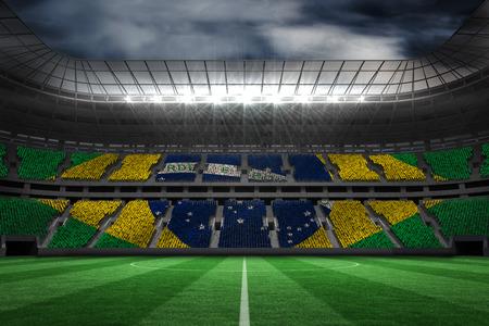 brazil flag: Digitally generated brazilian national flag against large football stadium