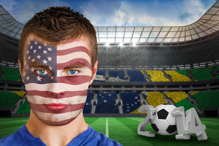 Composite image of serious young usa fan with facepaint against large football stadium photo