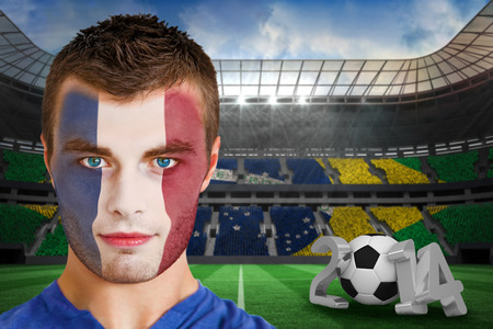 Composite image of serious young france fan with face paint against large football stadium photo