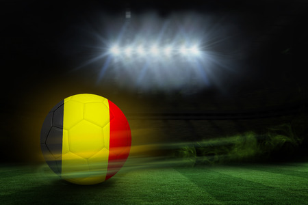 Football in germany colours against football pitch under spotlights photo
