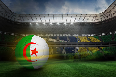 fast pitch: Football in algeria colours against large football stadium with brasilian fans Stock Photo