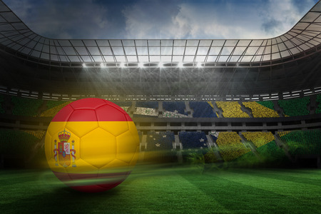 Football in spain colours against large football stadium with brasilian fans photo