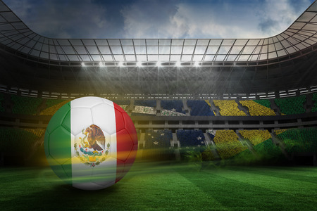fast pitch: Football in mexico colours against large football stadium with brasilian fans
