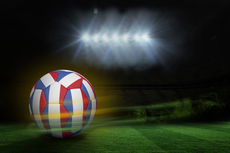 fast pitch: Football in french colours against football pitch under spotlights Stock Photo