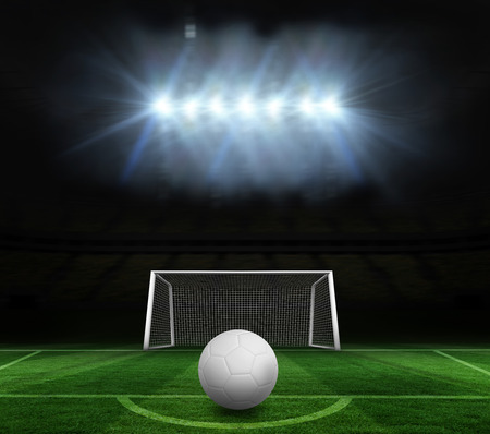goalpost: Digitally generated white leather football against football pitch and goal under spotlights