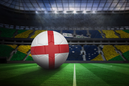 world sport event: Football in england colours in large football stadium with brasilian fans