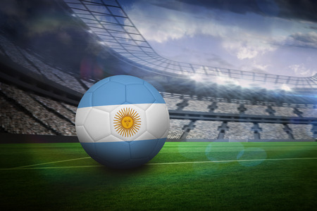 Football in argentina colours in large football stadium with lights photo