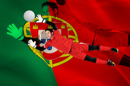 Fit goal keeper jumping up against digitally generated portugese national flag photo