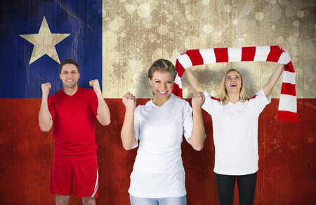 Composite image of various football fans against chile flag in grunge effect photo