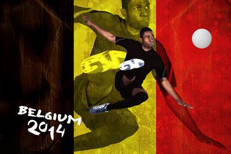 Football player in black kicking against belgium flag in grunge effect photo