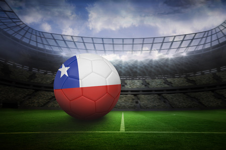 Football in chile colours in large football stadium with lights photo