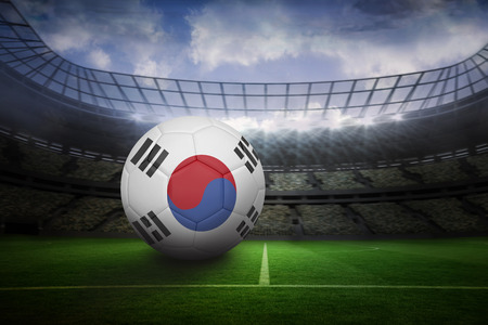 Football in south korea colours in large football stadium with lights photo