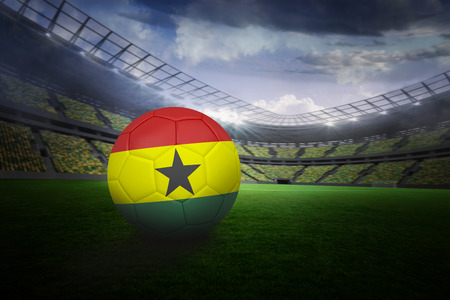 Football in ghana colours in large football stadium with lights photo