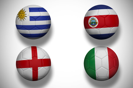 Composite image of group d footballs for world cup against white background with vignette photo