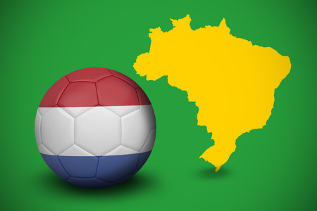 Football in holland colours against yellow brazil outline on green photo