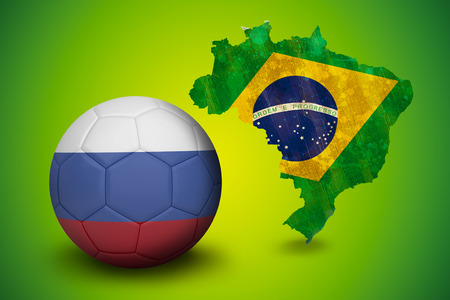 Football in russia colours against green brazil outline with flag photo