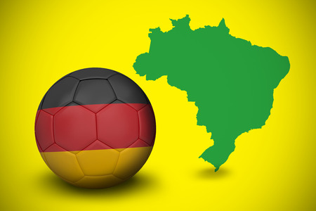 Football in germany colours against green brazil outline on yellow  photo