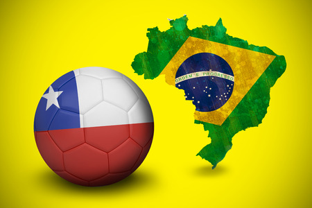 Football in chile colours against green brazil outline with flag on yellow photo