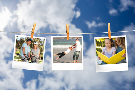 Composite image of instant photos hanging on a line against cloudy sky photo