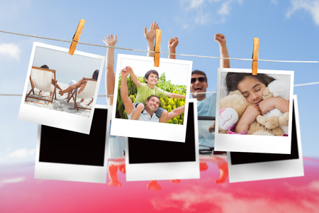 woman hanging toy: Composite image of instant photos hanging on a line against cheering couple in convertible