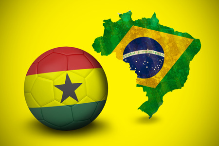 Football in ghana colours against green brazil outline with flag on yellow photo