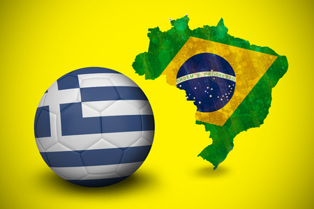 Football in greece colours against green brazil outline with flag on yellow photo