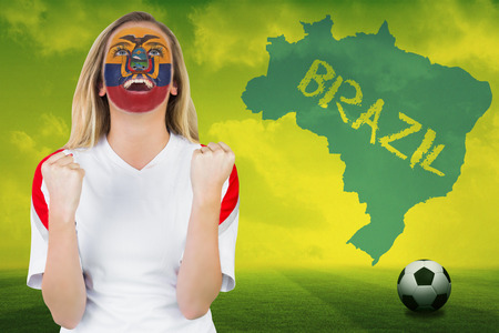 Excited ecuador fan in face paint cheering against football pitch with brazil outline and text photo