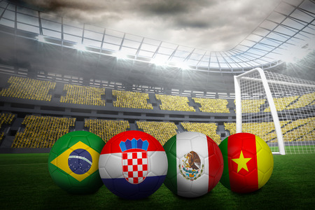 Group a world cup footballs in large stadium photo