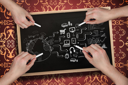 Composite image of multiple hands drawing brainstorm with chalk against blackboard photo