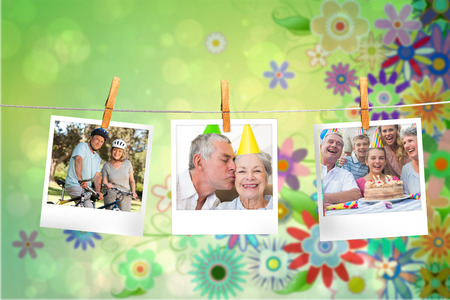 composite image: Composite image of instant photos hanging on a line against green floral design Stock Photo
